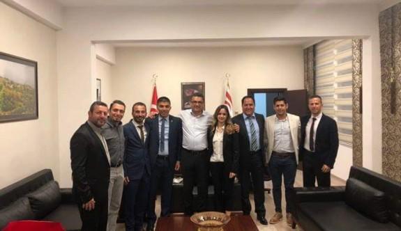 Erhürman, Üniversite Sporları Federasyonu yönetimini kutladı